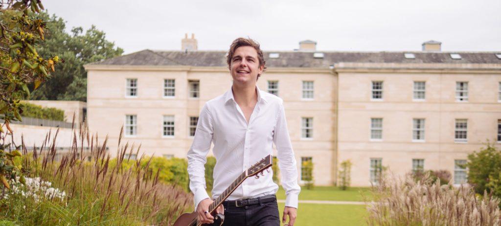 Acoustic Guitarist walks to play wedding ceremony music at Rudding Park Hotel Harrogate