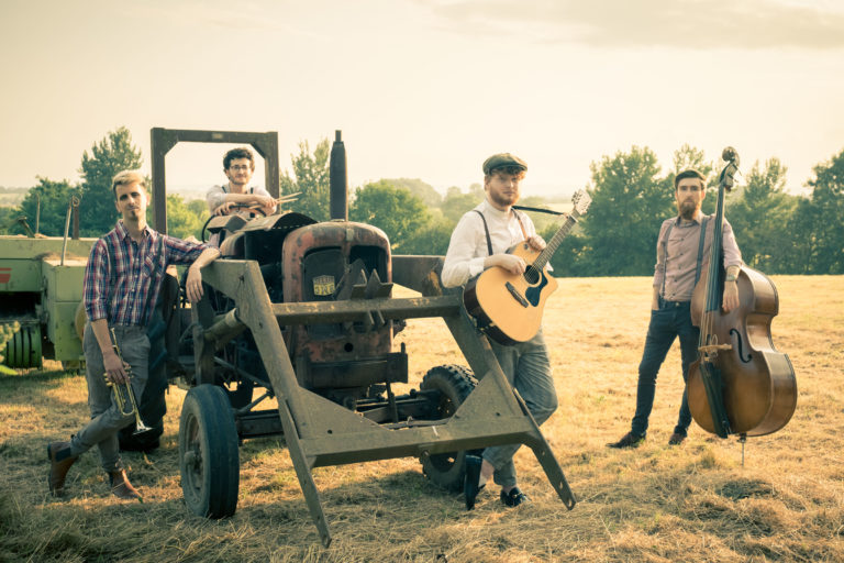 Sons of men folk band with tractor